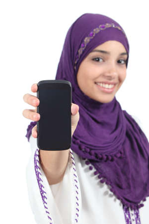 Arab woman with a hijab showing a blank smartphone screen isolated on a white background