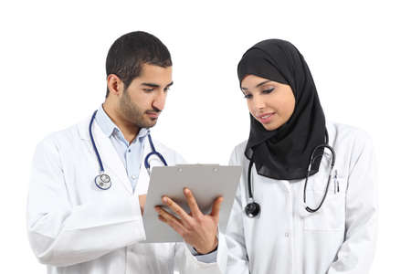 Saudi arab doctors diagnosing looking a medical history isolated on a white background