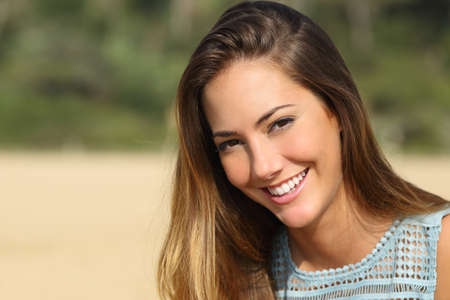 Portrait of a woman with a white teeth and perfect smile outdoorsの写真素材