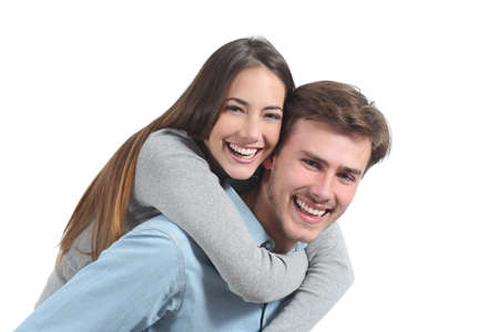 Funny couple laughing and looking at camera isolated on a white background