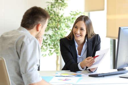 Boss showing a good job congratulating an employee at office