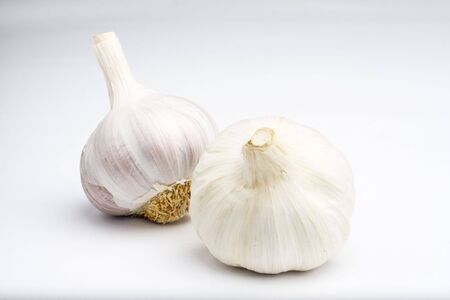 natural raw garlic isolated on a white background