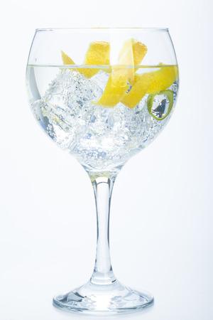 orange lemon and lime gin tonic isolated over white background