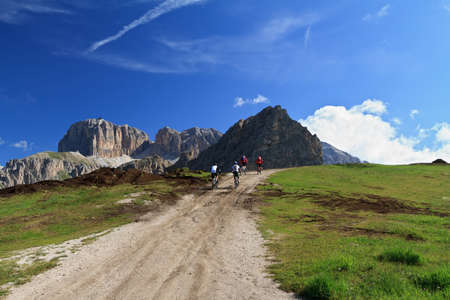 biker on high mountain road, Italian Dolomites