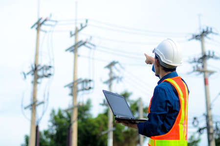 Photo for Engineer electric checking and maintenance of electric - Royalty Free Image