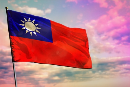 Fluttering Taiwan Province of China flag on colorful cloudy sky background. Taiwan Province of China prospering concept.