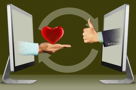 online concept, hands from laptops  heart and thumbs up