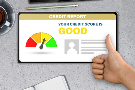 Photo pour good credit score technology concept - hand with tablet computer shows like, thumb up   on stone table background - image libre de droit