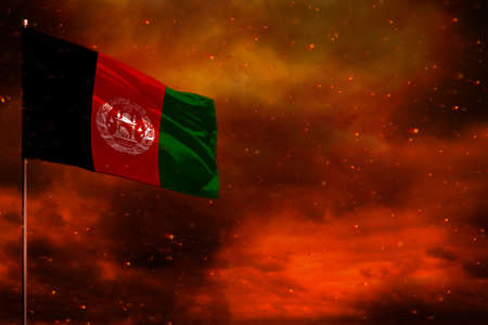 Photo pour Fluttering Afghanistan flag mockup with blank space for your data on crimson red sky with smoke pillars background. Afghanistan problems concept. - image libre de droit