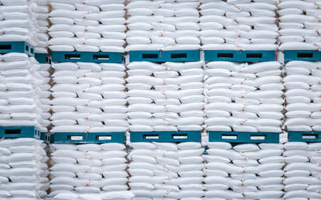 Photo pour stack of white bag in the warehouse - image libre de droit