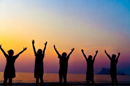 Photo pour A group of women rise hands up to sky freedom concept with blue sky and summer beach sunset background. - image libre de droit