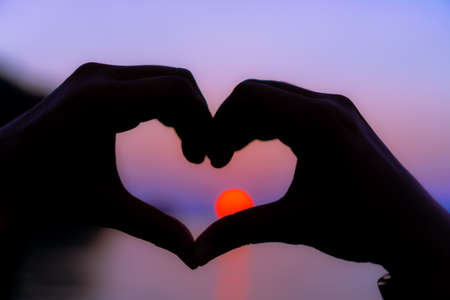 Photo for Woman hand do heart shape on sunset beach nature tropical background. - Royalty Free Image