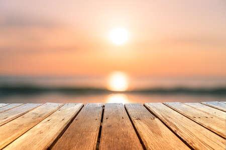 Foto de Selective focus of old wood table with blur beautiful beach background for display your product. - Imagen libre de derechos
