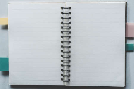 Photo for Top view of blank space white notebook and pen with tropical leaf as frame background. - Royalty Free Image