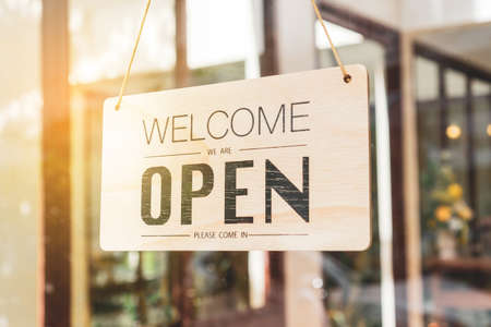 Photo pour A business sign that says open on cafe or restaurant hang on door at entrance. Vintage color tone style. - image libre de droit