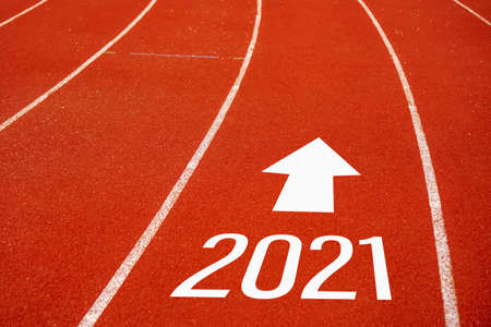 Photo pour Start line to 2021 on running court represents the beginning of a journey to the destination in business planning, strategy and challenge or career path, opportunity concept. - image libre de droit