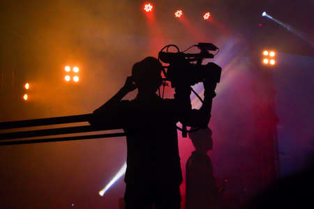 Cameraman silhouette on a concert stage