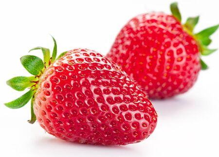 Photo pour two strawberry berries on a white background. - image libre de droit