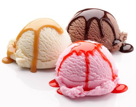 Photo pour Ice cream balls glazing chocolate caramel on a white background. - image libre de droit