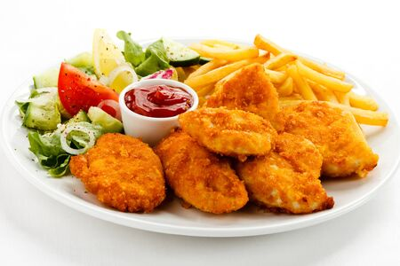 Photo pour Nuggets chicken fillet sauce tomatoes fries white background . - image libre de droit