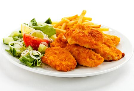 Photo pour Nuggets chicken fillet fries french vegetables lemon greens . - image libre de droit