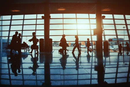 business travel, silhouettes of walking people in the airport