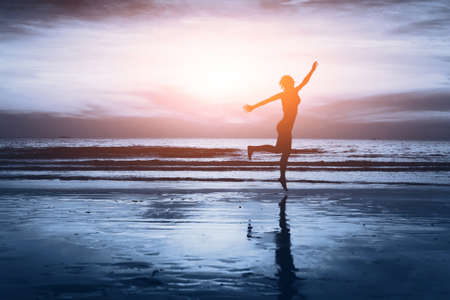 Photo pour healthy life, silhouette of carefree woman on the beach - image libre de droit
