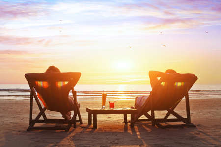 happy couple enjoy luxury sunset on the beach during summer vacationsの写真素材