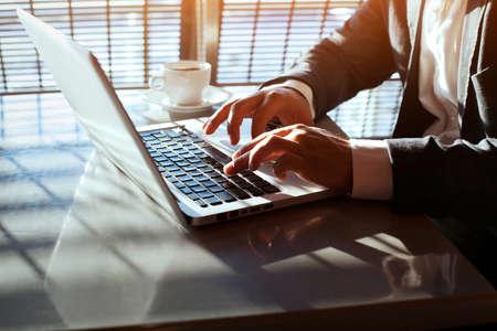 Photo pour working on laptop, close up of hands of business man - image libre de droit