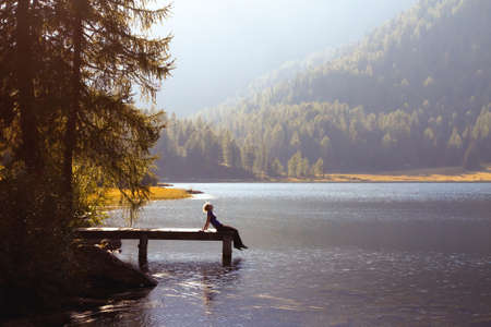 Photo pour young woman enjoy the nature on the mountain lake - image libre de droit