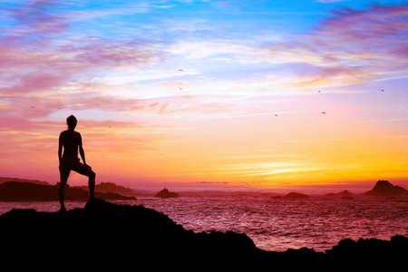 Photo for wellbeing concept, silhouette of person enjoying beautiful sunset with view of ocean - Royalty Free Image