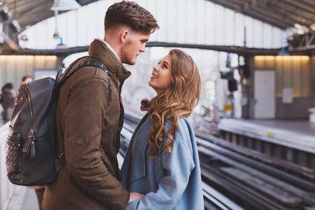 Foto de long distance relationship, couple on platform at the train station, meeting or parting concept - Imagen libre de derechos