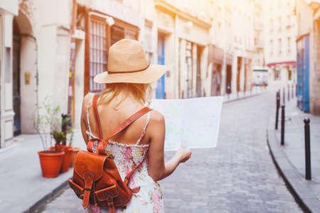 Foto de woman tourist looking at the map on the street of european city, travel to Europe - Imagen libre de derechos