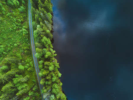 Foto de aerial nature background, top view of road and  beautiful texture of water and forest - Imagen libre de derechos
