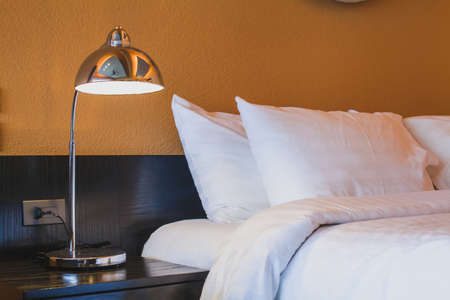 Photo pour hotel room abstract interior, lamp near the bed - image libre de droit