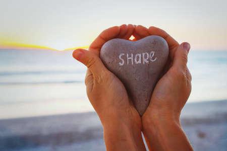 Foto de share concept, hands holding stone with word written on it - Imagen libre de derechos