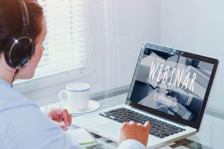 Photo pour woman watching webinar online on computer, business education concept, coaching - image libre de droit