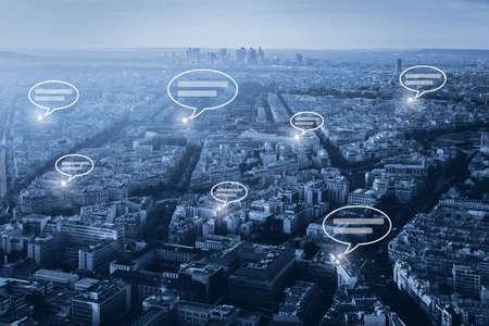 Photo pour online communication concept, social network with speech bubbles on blue cityscape background - image libre de droit