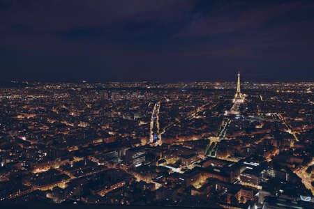 Photo pour PARIS, FRANCE - AUGUST 29 2015: beautiful night panoramic aerial view of Paris and illuminated Eiffel Tower, city lights - image libre de droit