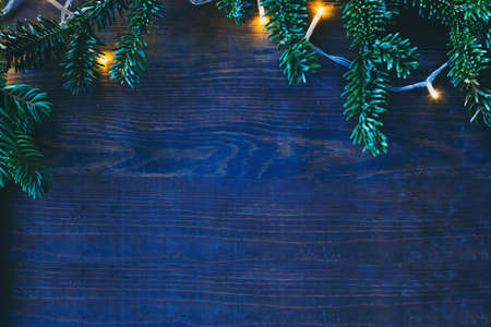 Photo for blue cold christmas background with cozy yellow lights and copyspace - Royalty Free Image