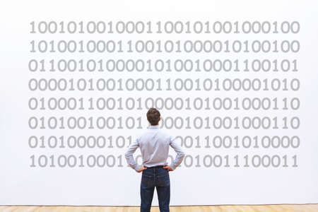Photo pour man programmer looking at binary code, coding concept, data encryption - image libre de droit