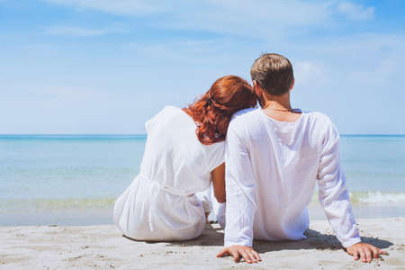happy couple on the beach, summer holidays or honeymoon background