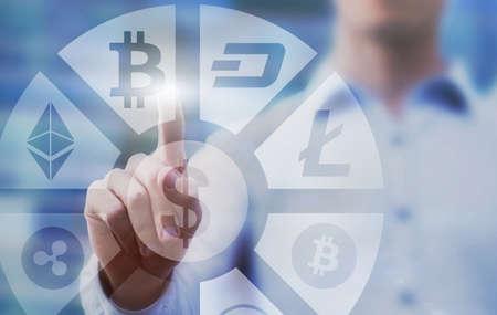 Foto de business man pressing buttons with bitcoin, litecoin and ethereum  on virtual touch screen interface, digital money concept, cryptocurrency - Imagen libre de derechos