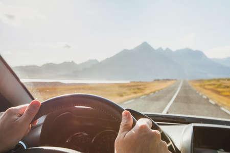 Foto für travel by car, road trip adventure, hands od driver on steering wheel in sunny day - Lizenzfreies Bild