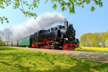 Historical German steam train in spring, Rugen, Germany