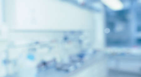 Foto de Blurred laboratory interior, scientific background with copy-space. Modern research facility room out of focus. Blue toned blurred image. - Imagen libre de derechos