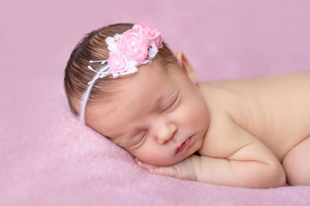 Photo pour portrait of a newborn baby girl sleeping on a pink blanket background, place for text, healthy baby sleep. - image libre de droit