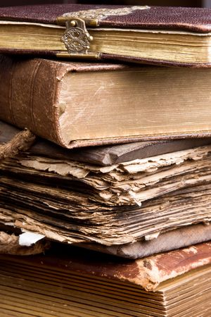 Several antique books stacked, one of them over 300 years old