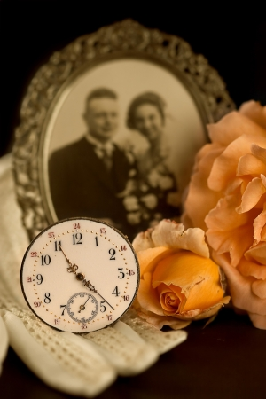 Old wedding photograph, wedding gloves, rose and antique watch