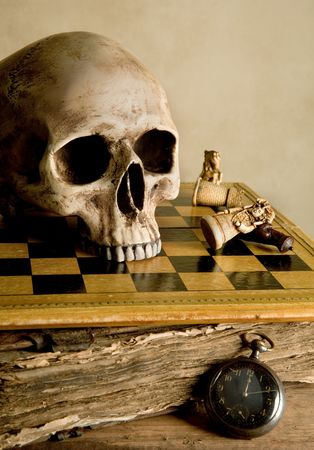 Vintage image with skull on an antique checkboard